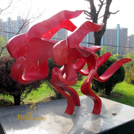Three person running sculpture