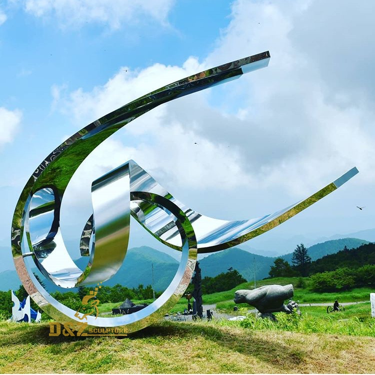 A curved stainless steel sculpture