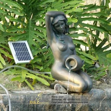 Female pouring bronze fountain