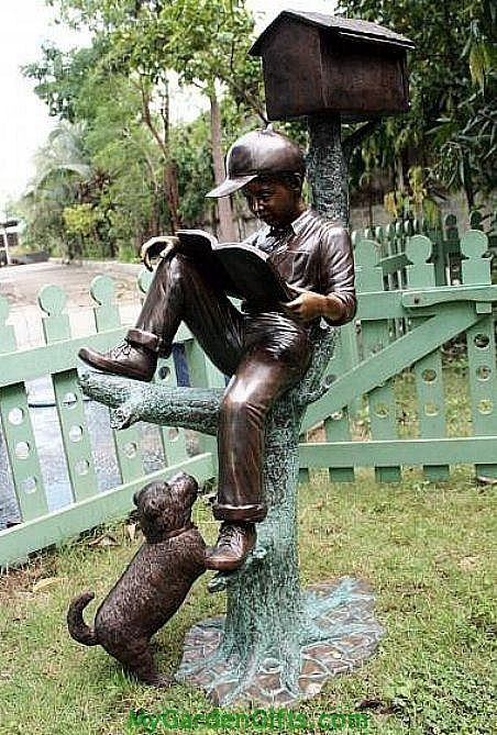 reading boy mailbox sculpture