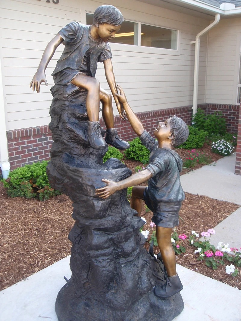 Helping hands mountain sculpture