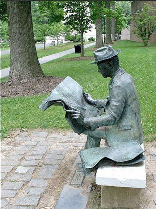 J Seward Johnson reading newspaper male