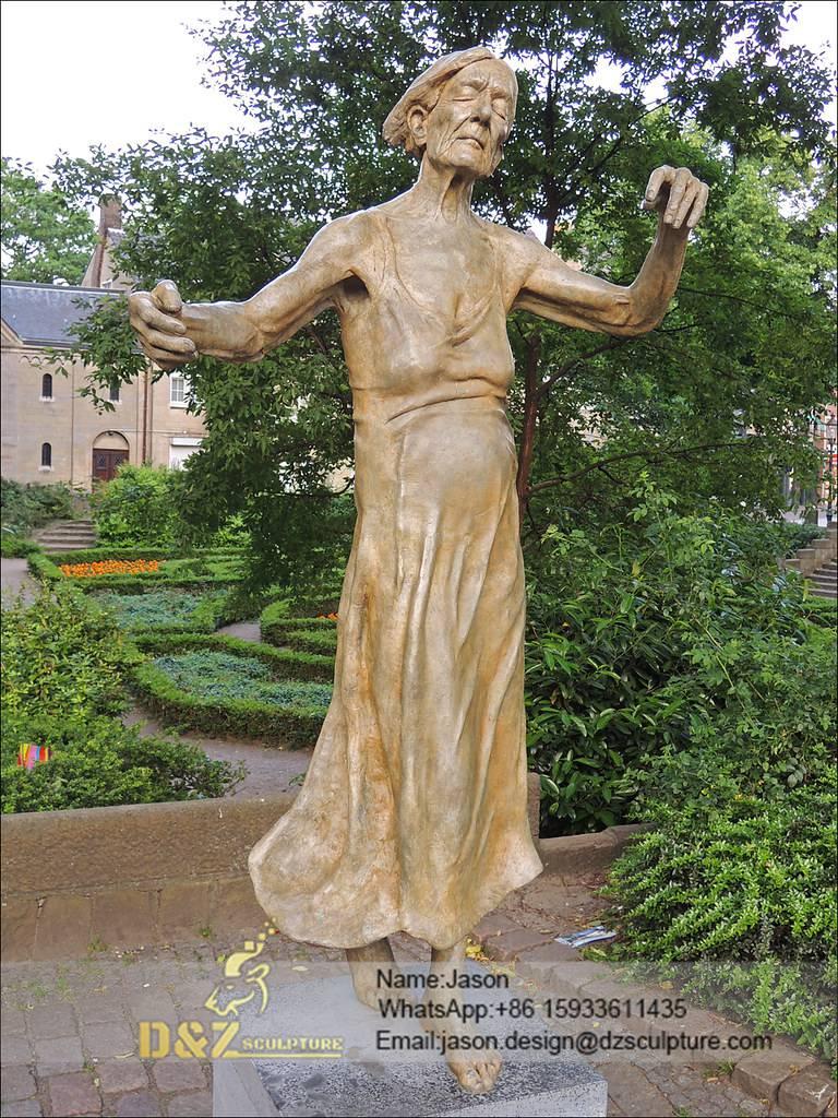 a woman dancing sculpture