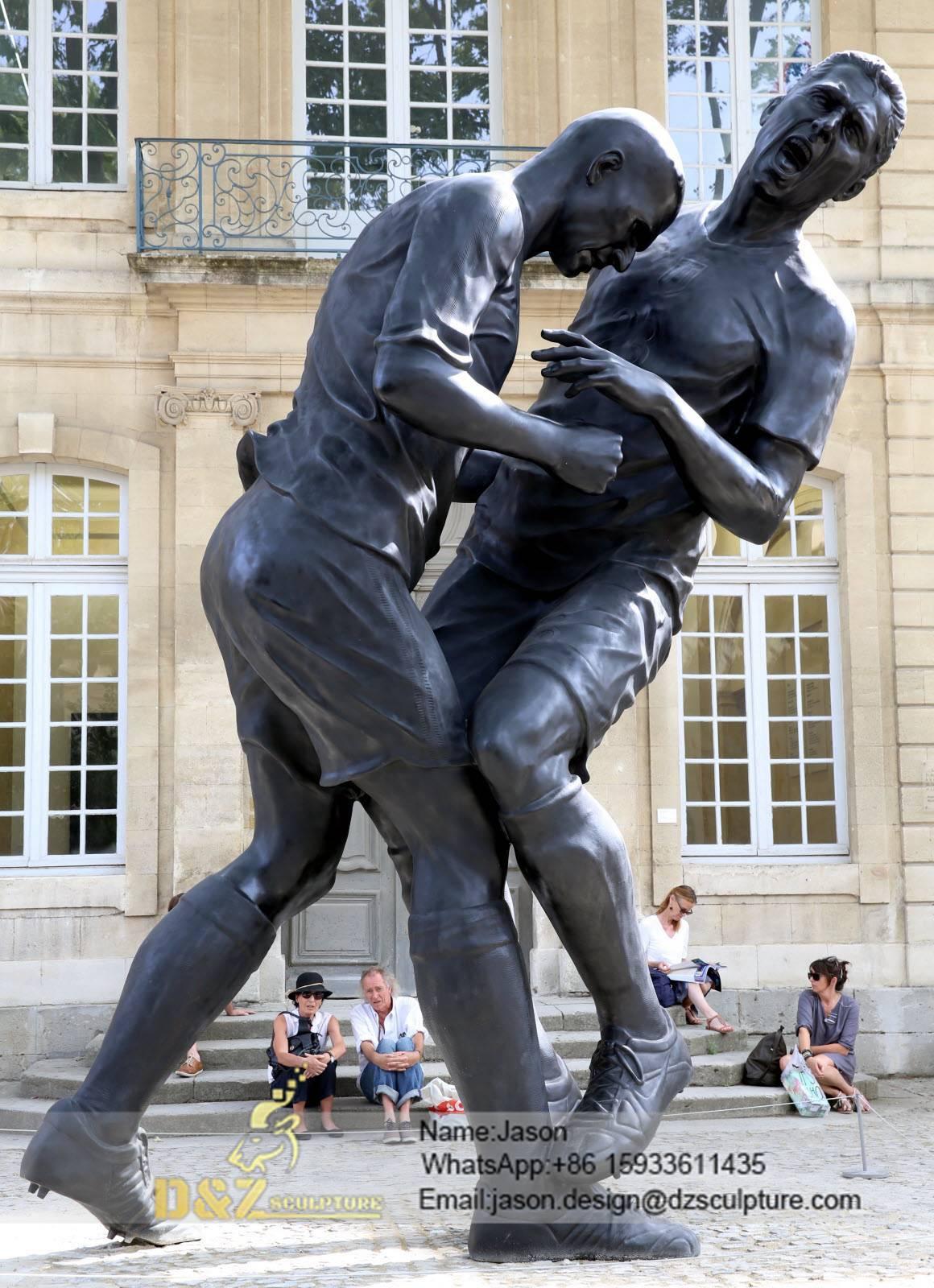 figure coup fighting sculpture