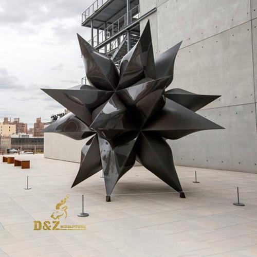 modern black star sculpture