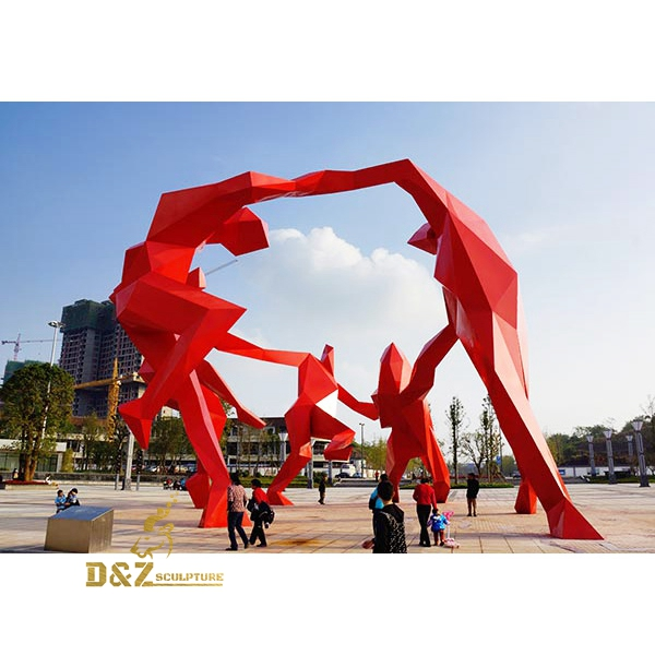red figures dancing sculpture