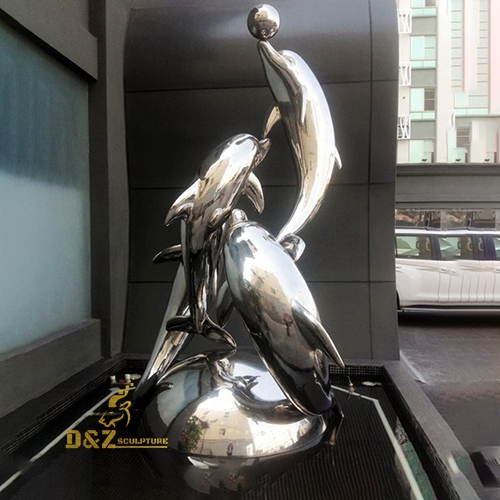 dolphins performing polished sculpture