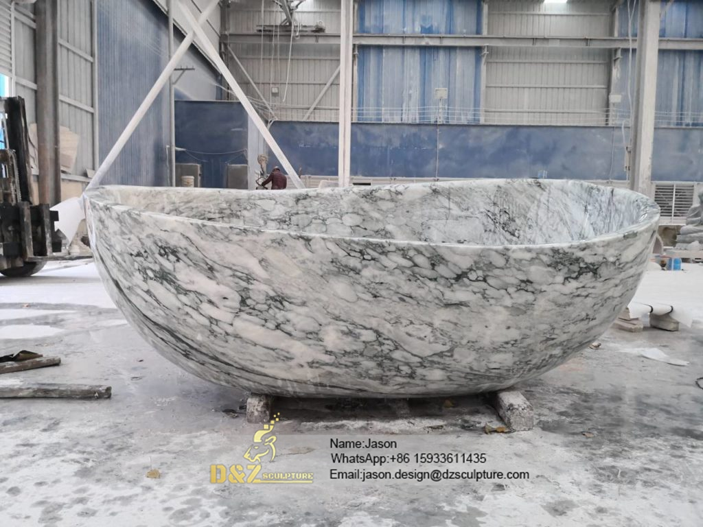 Freestanding stone bathtub