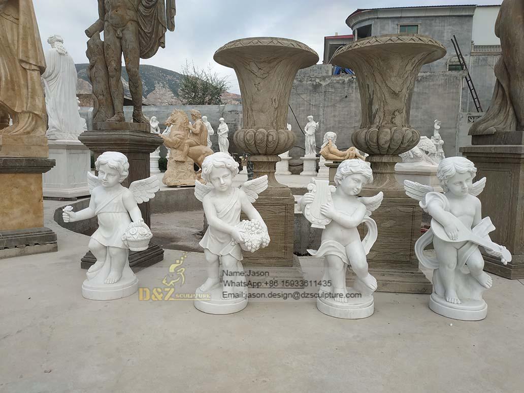 Four fairy children sculptures
