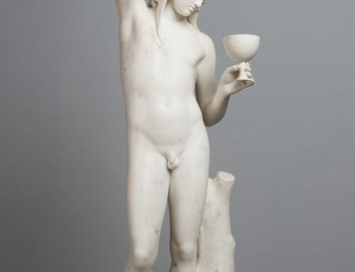 Man pours wine sculpture