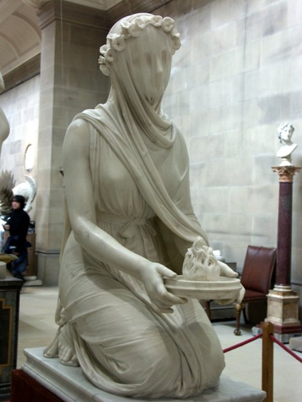 Masked woman statue