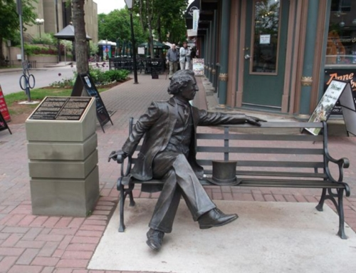 Man sitting on bench sculpture
