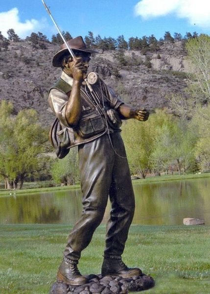 monumental man fishing sculpture