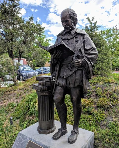 Shakespeare reading book sculpture