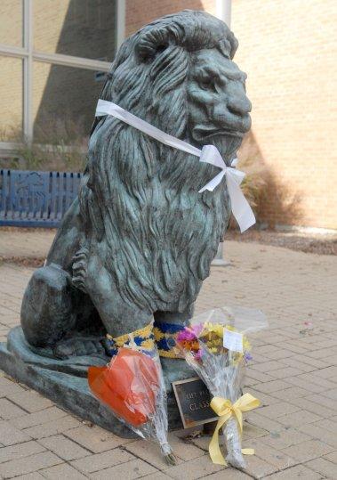 Sitting bronze lion